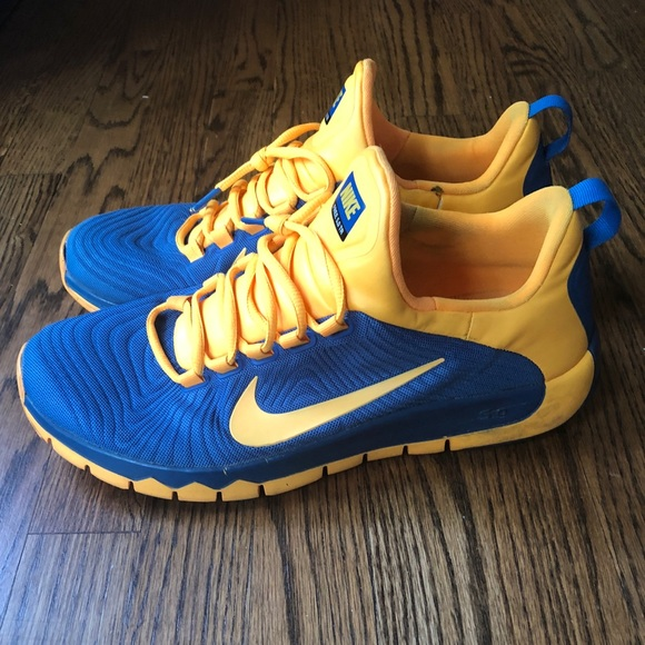 wholesale dealer 0aad7 8d15e Nike Shoes Men s Nike Free 5.0 TR Blue   Gold. M 5b0eb8c9d39ca246bc22d5a6